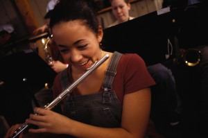 Young Flutist Laughing