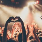 people-enjoying-rock-concert-with-heartshape-hand-gesture